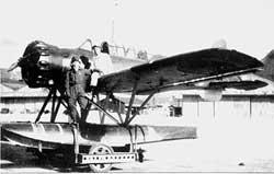 """Nobuo Fujita standing by his Yokosuka E14Y """"Glen"""" seaplane. (Wikipedia)"""